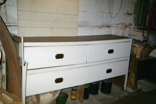 Old fashioned pattern drawers used in stores back in the day... stacked as a work station in basement.  Paid $25 for the 2.