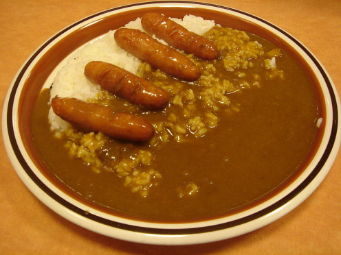 Campfire curried sausages, served on a bed of rice