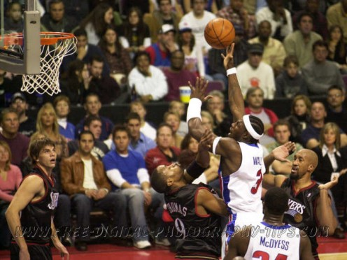 Ben Wallace formerly of the Detroit Pistons takes a shot over some Philadelphia 76ers during a NBA basketball game in Detroit Michigan. This photo was taken with a Nikon D1 back in November 6, 2004. It was a great camera back in 2000, with 4.5 frames