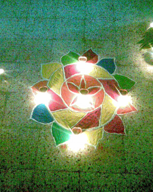 Diwali, the festival of lights, RANGOLI decorated with earthen lamps!