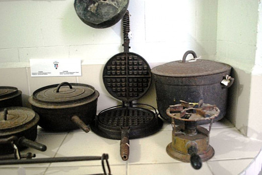 In days gone by all cookware was cast iron, rough and black and cleaning the bottoms was never an issue.