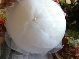 Pin the tulle on one side of the ball.