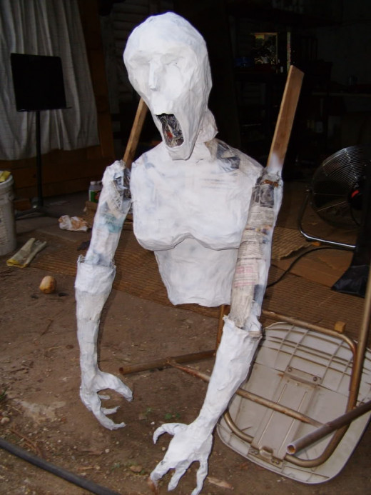 A unique paper mache of a half bodied hallow