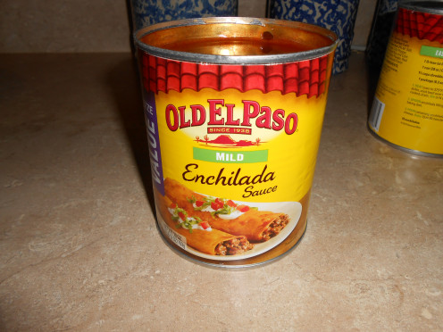 Cheese enchiladas can be served many different ways.  My family loves them topped with Old El Paso Enchilada Sauce.
