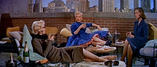 """Marilyn Monroe, Betty Grable and Lauren Hutton in  """"How to Marry a Millionaire."""" Note the elegant, subtle outfits."""
