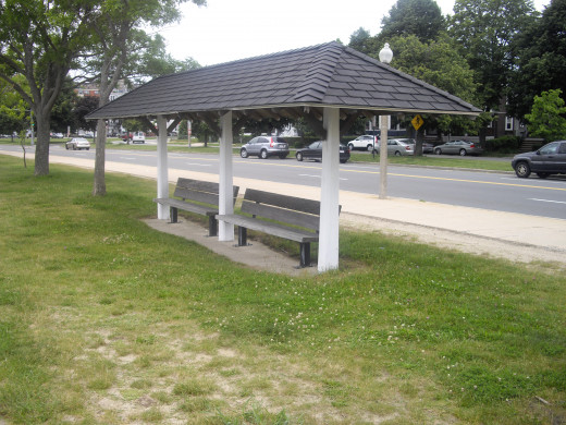 One of the many covered benches along the Harborwalk that I like to sit on