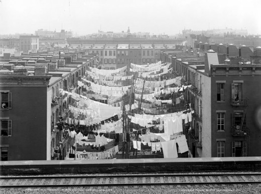 A New York City tenement complex from around 1900. These tenements housed many people in tight quarters.