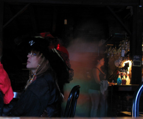 I can't say I've ever seen a ghost here, but I can say I've had taken very strange photos. I was sitting next to the fireplace when I took this. It was during PirateCon, which explains the woman's hat next to me. This photo is completely unedited.