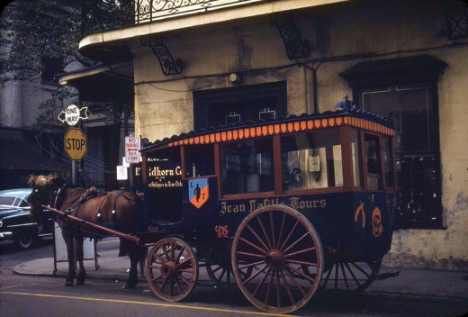 Photo from 1953, taken across the street from the Blacksmith shop. This tour company is long gone, but carriages still stop and get curbside service from the bar for their passengers!