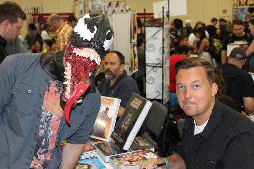 Rick Remender (the writer of the recent Venom arc) and a crazed fan.