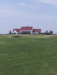 Looking up the 18th fairway at the final green and the clubhouse at King's Walk Golf Course in Grand Forks, ND.