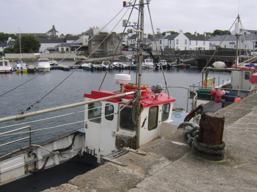 Fishing boats moored at Bowmore pier
