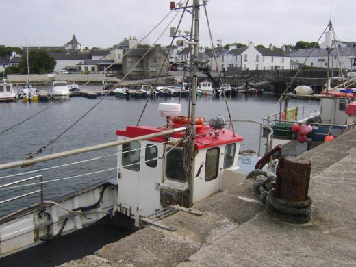 Fishing boats moored at Bowmore pier