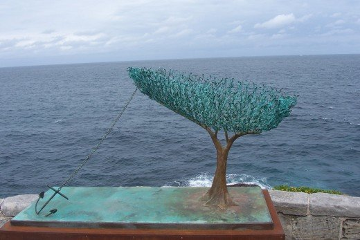 "Nexus by Alex Kosmas. Made of bronze and measures 240 cm x 240cm x 100 cm. The artist statement ""The fast paced world forgets its connection to nature. ""Nexus"" represents our life boat."