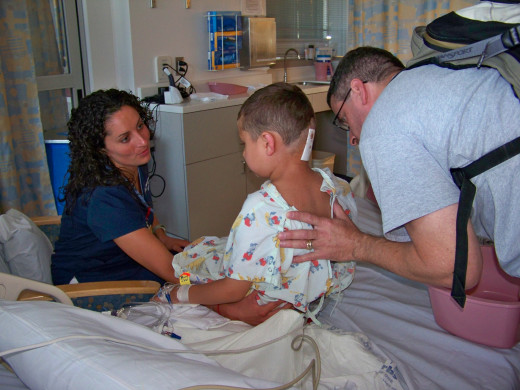 Cian, 6 yrs, sitting for the first time post-op/ Dad and nurse, UCLA 2011
