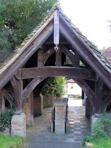 A Lych gate. This was where the coffin would pass through on its way to the cemetery. The stones in the middle of this one, was for the coffin to be rested while prayers were said.