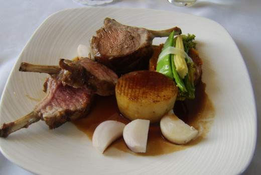 Rack of lamb with fondant potato and assorted vegetables