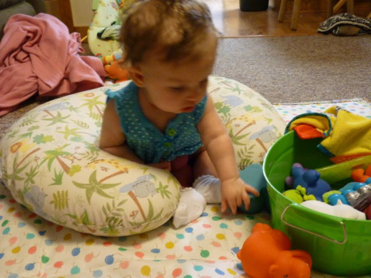The boppy pillow used to teach my daughter how to sit up (she was 5 months old).