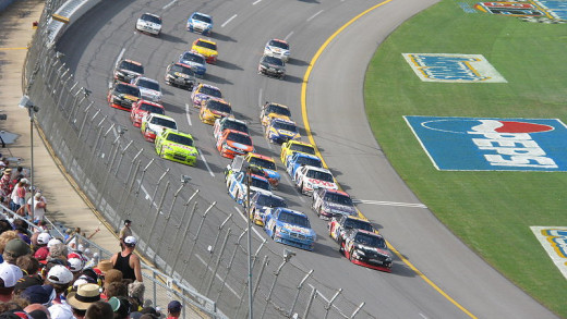 Drivers racing through the tri-oval area of Talladega Superspeedway in 2008.