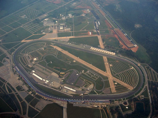 Talladega Superspeedway from the air. Note the crossing runways that make up part of the infield. The track was built on the site of an old Air Force Base in Alabama.