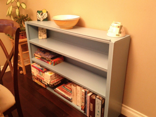 "Refurbished wood shelving unit ""free"" from the roadside. A few $'s for paint and trim creates a prettty organizational space for our dining room."