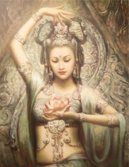 Buddhist goddess Quan Yin holding a lotus flower