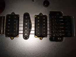 Switched out the DiMarzio/IBZ bridge pickup for a DiMarzio Mo Joe. Much better.