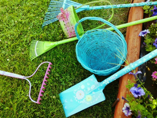 A collection of hand painted gardening equipment.