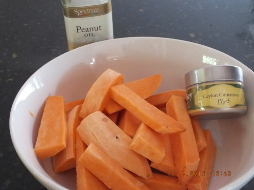 Peel and slice your sweet potatos and place in a large bowl.