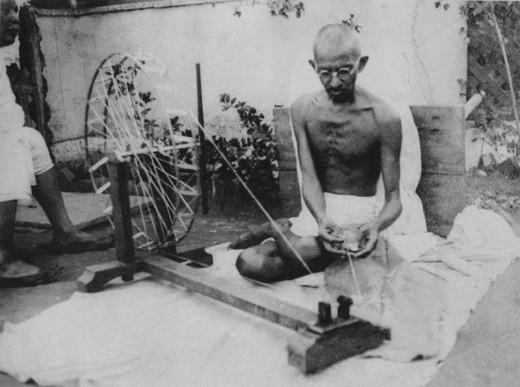 Gandhi spinning.