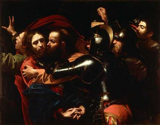 The Taking of Christ, by Caravaggio (c. 1600). Judas is kissing Jesus to indicate him to the guards of the priests.