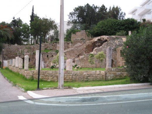 Carthage street with Roman ruins and modern buildings