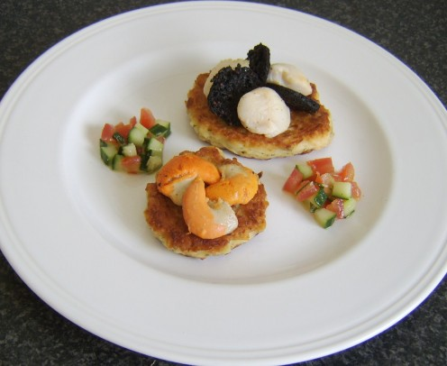 Pan seared king scallops, served with black pudding on potato cakes