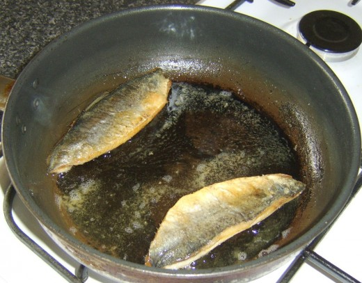 Herring fillets complete cooking on their flesh sides
