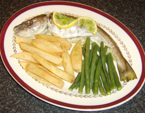 Whole baked whiting, served with homemade chips and trimmed green beans