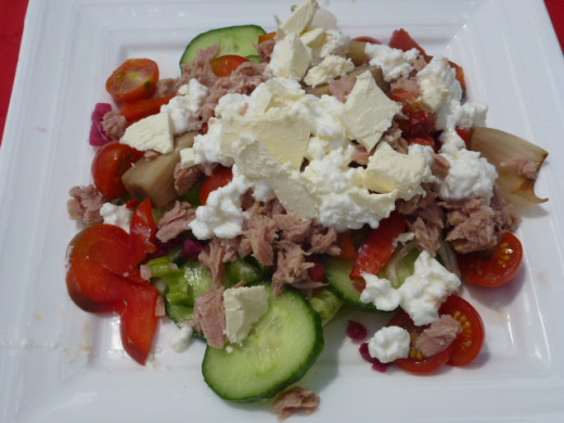 Healthy salad of mixed leaves, cucumber, tomatoes and cottage cheese