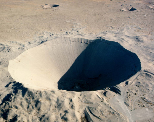 No; this is not the moon! It is a small part of the Nevada underground nuclear bomb test site.