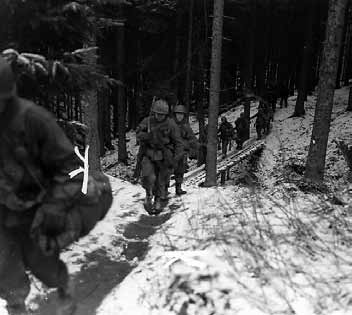 A squad of the 424th on the move in Berk, Germany, March 1945.