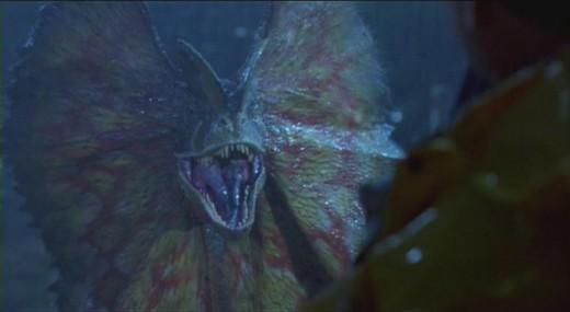 Dilophosaurus sprays Dennis Nedry with venom.
