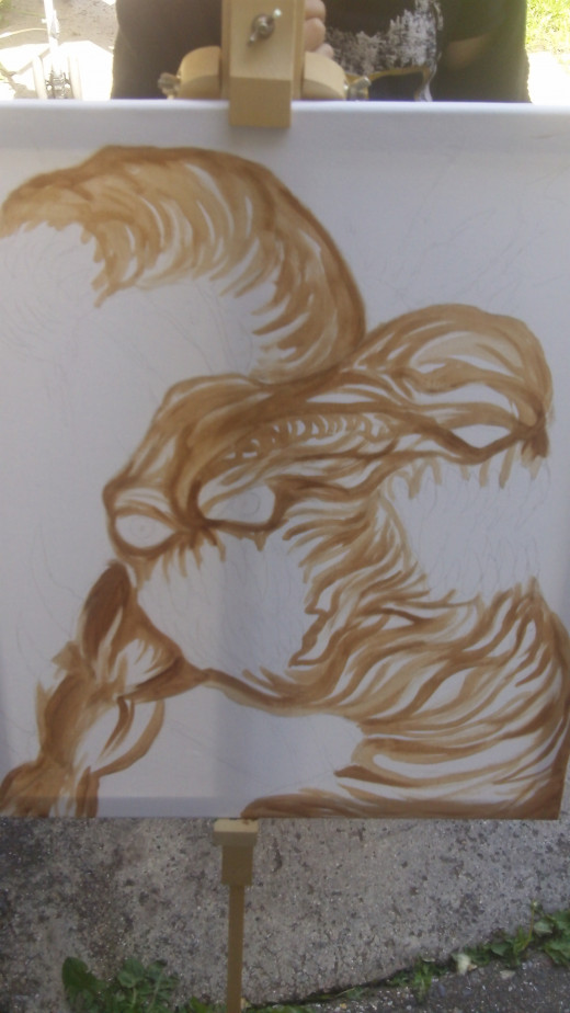 Continuing to paint the outlined creature