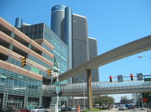 Downtown Detroit. Renaissance Center in the background, People Mover track in the foreground. A Skywalk is pictured in the middle.