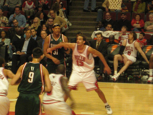 Joakim Noah (13) shows grit and tenacity on the boards.
