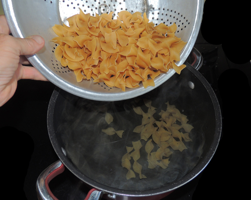 add noodles to rapidly boiling water