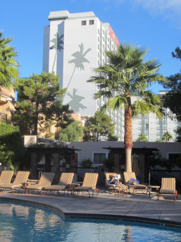 Swimming Pool at Desert Rose Resort in Las Vegas with Hooters Hotel and Casino in the background.