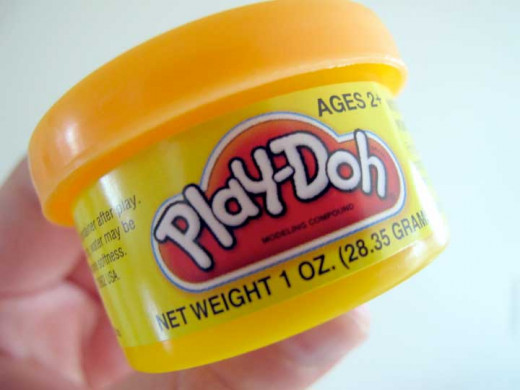 Play-doh is a great Halloween treat for young children.
