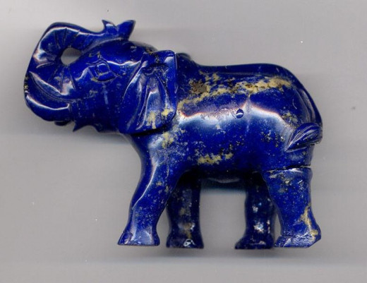 An elephant carved from Lapis Lazuil, showing the iron pyrite inclusions.