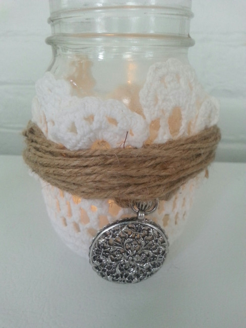 Attach another jewel accessory on the other side with an additional piece of jute twine. Clean off any excess glue or spray adhesive, insert the battery votive and enjoy!