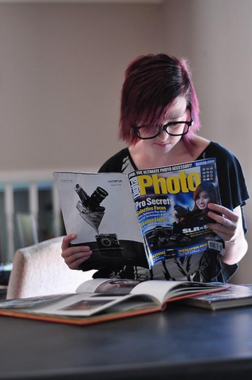 Browsing a photography magazine by Www.CourtneyCarmody.com on Flickr