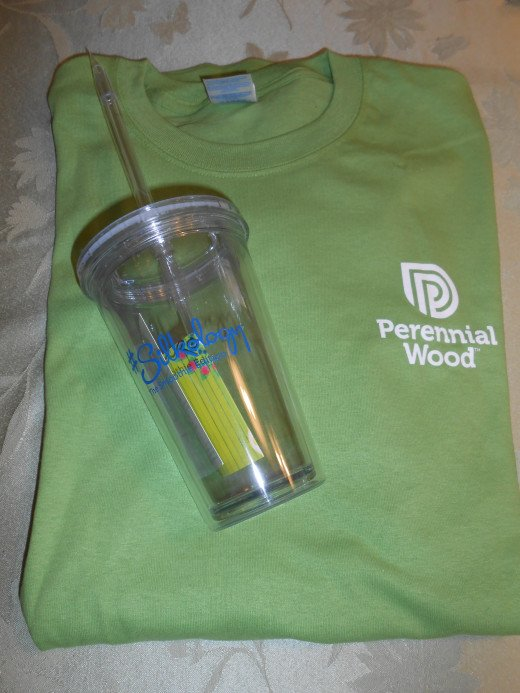 Two of the five prizes I have won during th month of July: a T-shirt from Perennial Wood and a tumbler fro Silkology. It's fun to get prizes in the mail instead of bills!