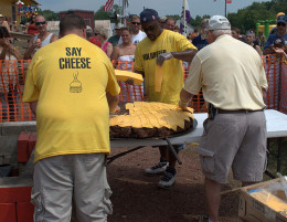 Cheese is being put on the giant cheese burger at the Burger Fest in Seymour, Wisconsin on August 4, 2012.